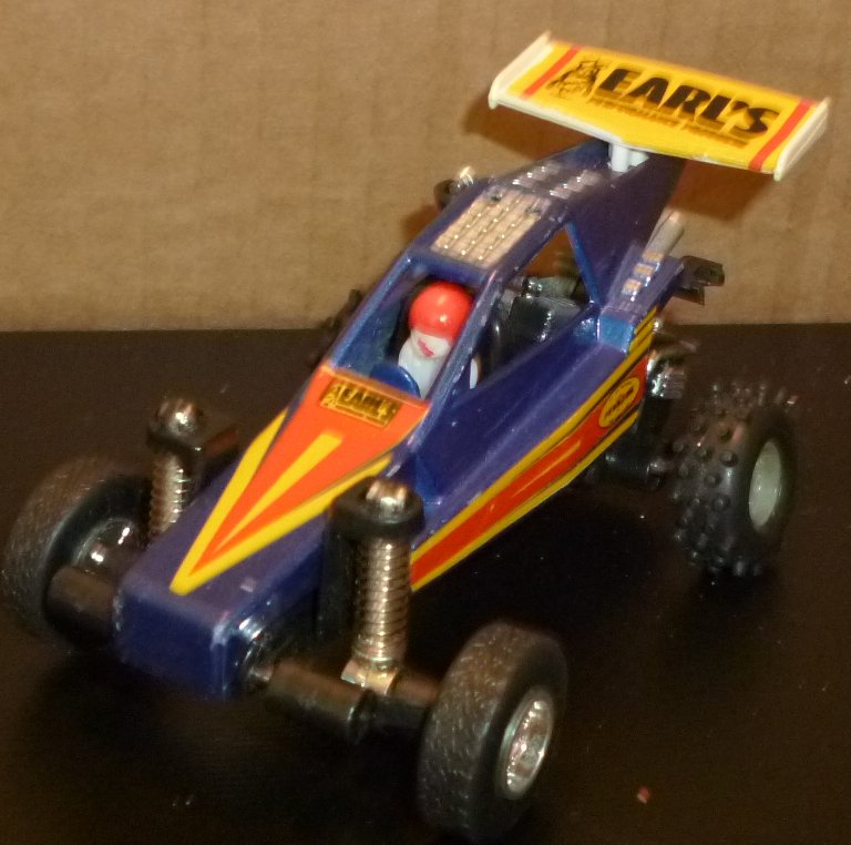 "M.C Toy EARL'S race Car with driver 4"" long"