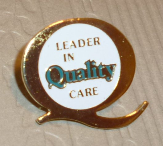 LEADER IN QUALITY CARE lapel Pin 0.75""